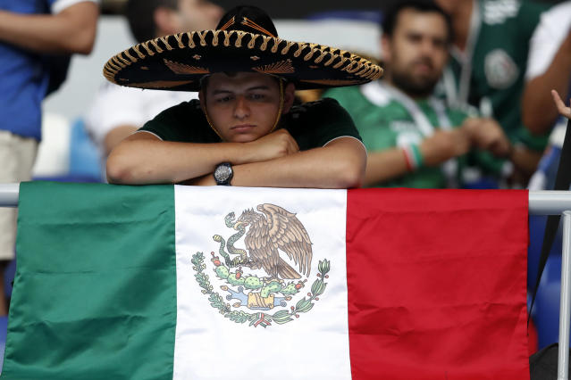 <p>A fan of Mexico sits on the stands after the round of 16 match between Brazil and Mexico at the 2018 soccer World Cup in the Samara Arena, in Samara, Russia, Monday, July 2, 2018. Mexico lost 0-2. (AP Photo/Eduardo Verdugo) </p>