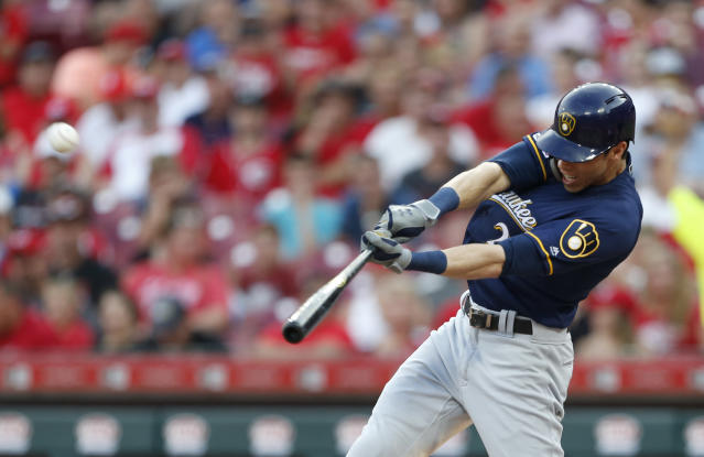 FILE - In this July 2, 2019, file photo, Milwaukee Brewers' Christian Yelich hits a solo home run off Cincinnati Reds starting pitcher Tanner Roark during the fourth inning of a baseball game in Cincinnati. Josh Bell and Yelich are among eight competitors in this years All-Star Game Home Run Derby, which is handing out a $1 million prize to the winner. (AP Photo/Gary Landers, File)