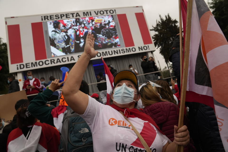 Supporters of presidential candidate Keiko Fujimori gather to protest alleged election fraud in Lima, Peru, Saturday, June 12, 2021. Supporters are hoping to reverse the results of the June 6th presidential runoff election that seem to have given the win to opponent Pedro Castillo amid unproven claims of possible vote tampering. (AP Photo/Martin Mejia)