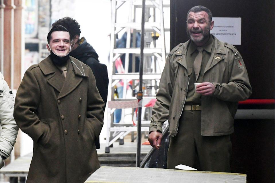<p>Costars Josh Hutcherson and Liev Schreiber take five on Tuesday on the Venice, Italy, set of <em>Across the River and Into the Trees.</em></p>