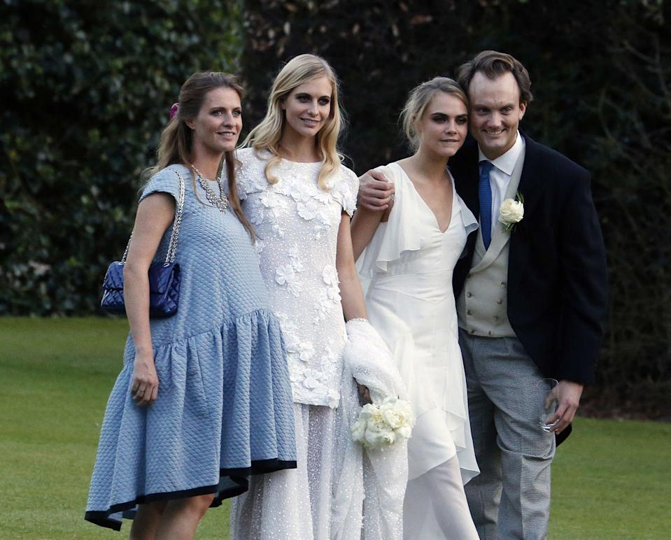 """<p>Cara Delevingne was one of 17 bridesmaids for her sister <a href=""""https://www.theknot.com/content/10-surprising-facts-about-poppy-delevingnes-wedding-including-ring-bearers-dressed-like-actual-bears"""" rel=""""nofollow noopener"""" target=""""_blank"""" data-ylk=""""slk:Poppy's wedding in 2014"""" class=""""link rapid-noclick-resp"""">Poppy's wedding in 2014</a>. Cara wore a flowy white dress perfect for the May weather.</p>"""