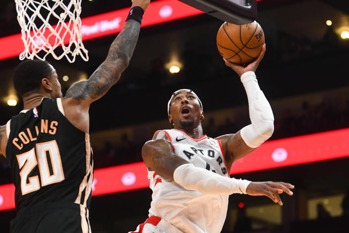 Toronto Raptors forward Rondae Hollis-Jefferson (4) shoots as Atlanta Hawks forward John Collins defends during the second half of an NBA basketball game Monday, Jan. 20, 2020, in Atlanta. Toronto won 122-117. (AP Photo/John Amis)