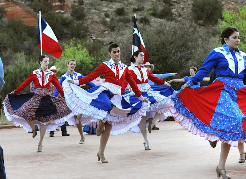 """In this May 21, 2013 photo, cast members from the musical drama """"Texas"""" rehearse on stage at the Pioneer Amphitheatre in Palo Duro Canyon, Texas. Five cast members of the musical were killed Monday night, Aug. 12, 2013 in an automobile accident near Dumas, Texas said Christopher Ray, a Texas Department of Public Safety spokesman. (AP Photo/Amarillo Globe-News, Sean Steffen)"""