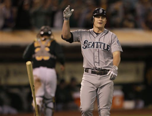 Seattle Mariners' Kyle Seager flips his bat after striking out against Oakland Athletics pitcher Jordan Norberto during the eleventh inning of a baseball game in Oakland, Calif., Friday, July 6, 2012. (AP Photo/Jeff Chiu)