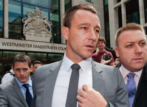 Former England captain John Terry (C) leaves Westminster Magistrates court in London on July 13. Terry received a rousing reception at his first match since his acquittal on racism charges as European champions Chelsea played to a 1-1 draw with Paris Saint-Germain