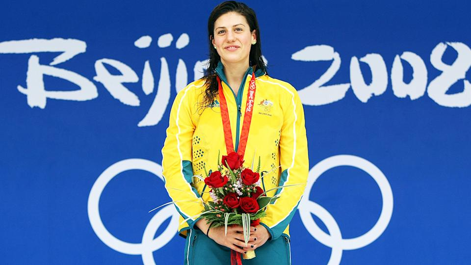 Stephanie Rice, pictured here with one of her three gold medals at the Beijing Olympics in 2008.