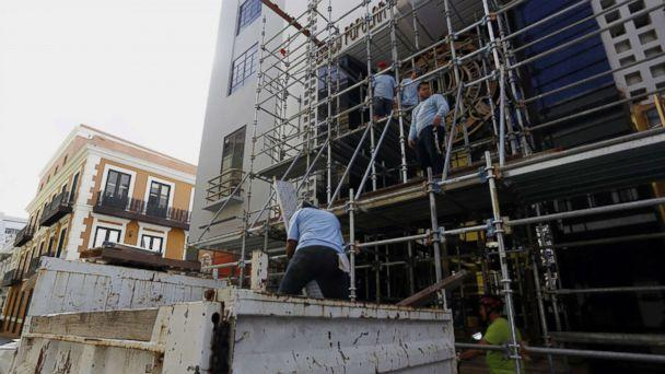 PHOTO: Workers dismantle a scaffold, in San Juan, Puerto Rico, as the city prepares for the arrival of hurricane Maria which is approaching both the Virgin Islands and Puerto Rico with winds of 160 miles per hour, storm surges and torrential rains. (Thais Llorca/EPA)