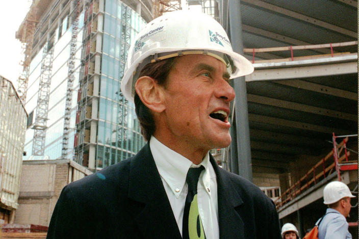 CORRECTS TO WEST, NOT EAST - FILE - In this Wednesday, July 15, 1998 file photo, architect Helmut Jahn tours a construction site in Berlin. Jahn, 81, was killed when two vehicles struck the bicycle he was riding on Saturday afternoon, May 8, 2021, while riding north on a village street in Campton Hills, about 55 miles west of Chicago. (AP Photos/Jockel Finck)