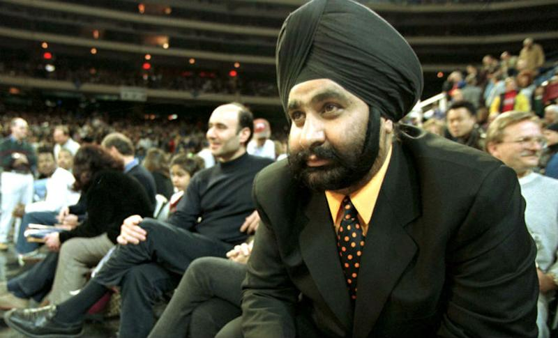 Nav Bhatia sits in the stands watching the game against the New York Knicks January 17, 1998. Reuters
