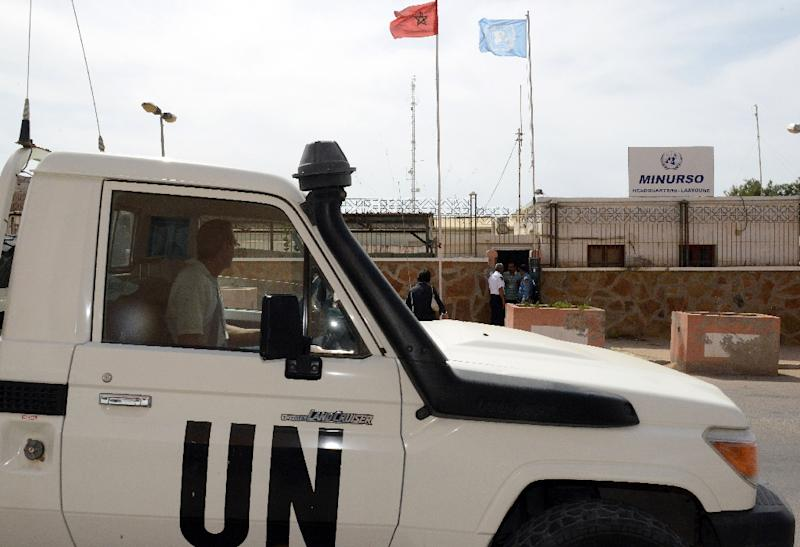 An UN vehicle drives past the headquarters of the United Nations Mission for the Referendum in Western Sahara (MINURSO), in Laayoune, the largest city of the disputed territory (AFP Photo/Fadel Senna)