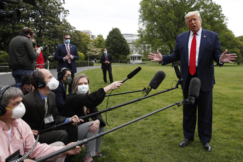 President Donald Trump speaks with reporters on the South Lawn of the White House as he departs on Marine One, Thursday, May 14, 2020, in Washington. Trump is en route to Allentown, Pa. (AP Photo/Alex Brandon)