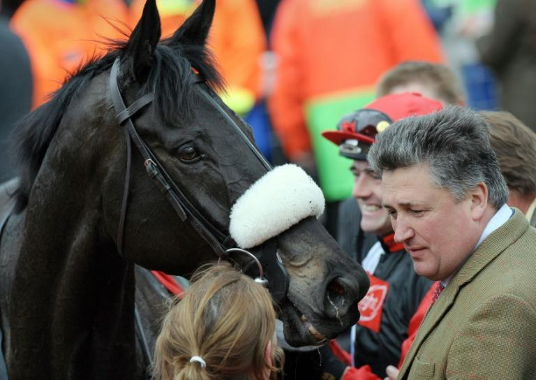Trainer Paul Nicholls holds a strong hand in his bid to win a 12th King George VI Chase with two-time winner Clan des Obeaux and Cyrname heading his four runners
