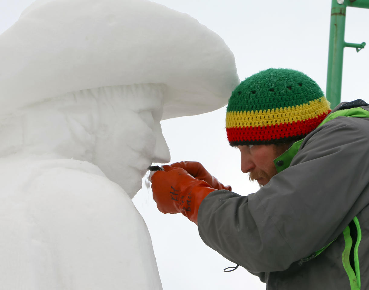 IMAGE DISTRIBUTED FOR THE BRECKENRIDGE RESORT CHAMBER - The captain of Team USA Breckenridge, Keith Martin shaving away snow of a bull rider's mustache on his 12 foot tall, 20-ton sculpture at the outdoor art gallery during the 23rd Annual International Snow Sculpture Championships in Breckenridge, Colo., on Friday, Jan. 25, 2013. Martin is joined with 15 international teams, the sculptures will remain on display through Feb. 3, 2013 (weather permitting). Visit www.gobreck.com for more information. (Nathan Bilow / AP Images for The Breckenridge Resort Chamber)