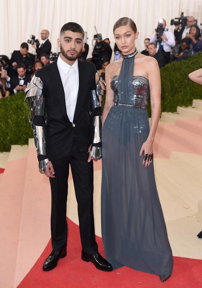 <p>Coordinating their looks like pros. <em>Dress, Tommy Hilfiger. Suit, Versace.</em></p>