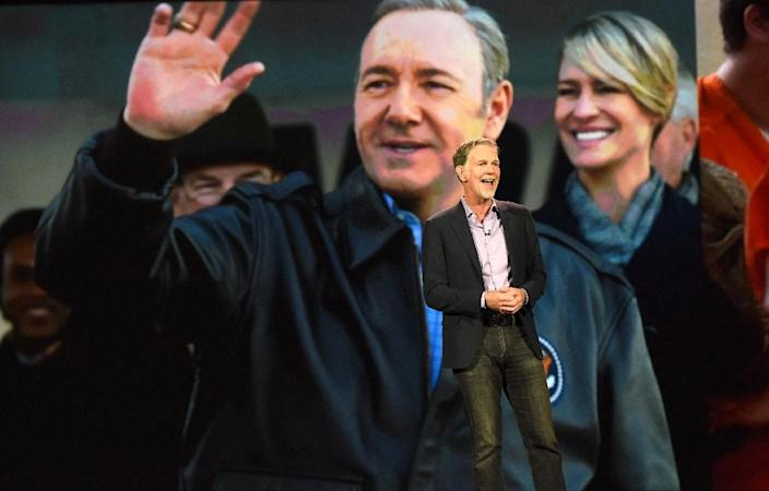 """Netflix CEO Reed Hastings speaks on January 6, 2016 in front of images from the award-winning show """"House of Cards"""" (AFP Photo/Robyn Beck)"""