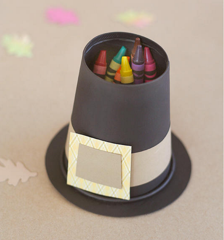 """<p>Stash crayons (or pencils and pens) in mini pilgrim hats and place 'em on the table to keep kids busy while the turkey roasts in the oven. </p><p><em><a href=""""http://www2.fiskars.com/Ideas-and-How-Tos/Crafting-and-Sewing/Parties-and-Entertaining/Thanksgiving-Kids-Table#.UneI5nCkrWx"""" rel=""""nofollow noopener"""" target=""""_blank"""" data-ylk=""""slk:Get the tutorial at Fiskars »"""" class=""""link rapid-noclick-resp"""">Get the tutorial at Fiskars »</a></em> </p>"""