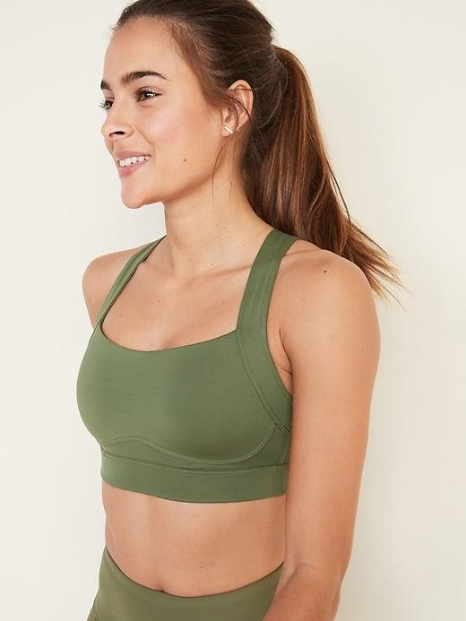 """<p>The <a href=""""https://www.popsugar.com/buy/High-Support-Cross-Back-Sports-Bra-571810?p_name=High%20Support%20Cross-Back%20Sports%20Bra&retailer=oldnavy.gap.com&pid=571810&price=25&evar1=fit%3Aus&evar9=47449829&evar98=https%3A%2F%2Fwww.popsugar.com%2Ffitness%2Fphoto-gallery%2F47449829%2Fimage%2F47452401%2FOld-Navy-High-Support-Cross-Back-Sports-Bra&list1=old%20navy%2Cfitness%20gear&prop13=api&pdata=1"""" class=""""link rapid-noclick-resp"""" rel=""""nofollow noopener"""" target=""""_blank"""" data-ylk=""""slk:High Support Cross-Back Sports Bra"""">High Support Cross-Back Sports Bra </a> ($25, originally $33) is made of a soft jersey that offers comfortable stretch. Since it's a cross-back sports bra that gives your shoulders a ton of freedom to move, I'd wear this for boxing.</p>"""