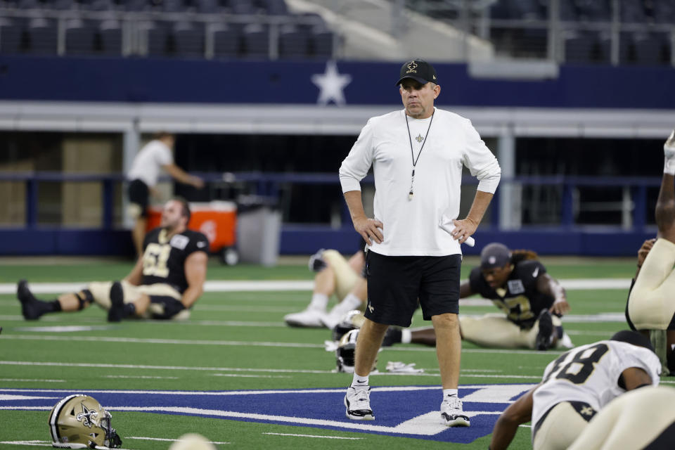 New Orleans Saints coach Sean Payton watches the team stretch as they prepare for an NFL football workout in Arlington, Texas, Monday, Aug. 30, 2021. Displaced by Hurricane Ida, the Saints went back to work Monday about 500 miles away in the home of another NFL team. (AP Photo/Michael Ainsworth)