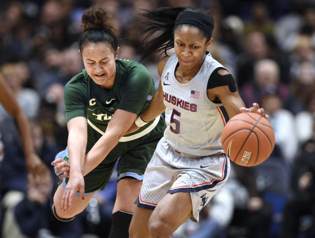 Connecticut's Crystal Dangerfield, right, steals the ball from Tulane's Kayla Manuirirangi in the first half of an NCAA college basketball game, Wednesday, Feb. 19, 2020, in Hartford, Conn. (AP Photo/Jessica Hill)