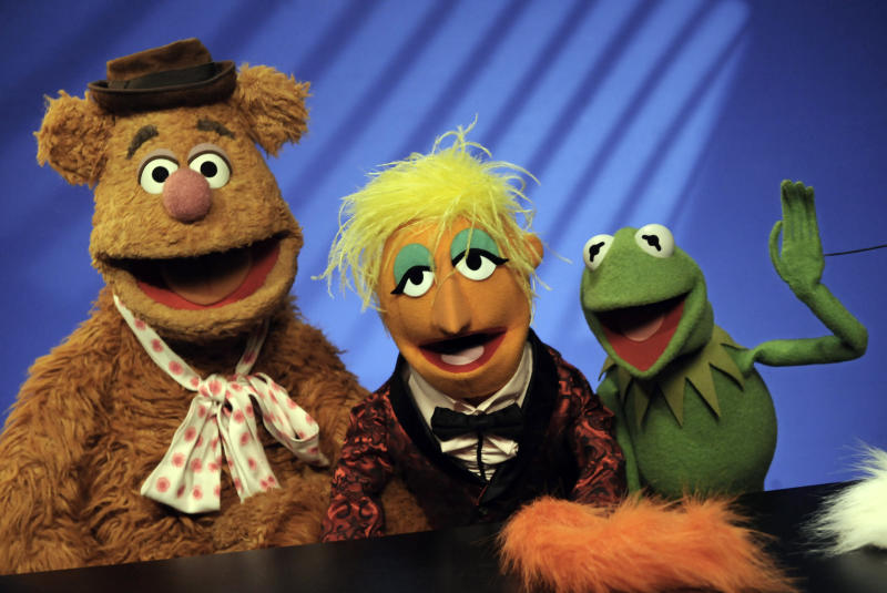 """FILE - In this Nov. 24, 2008 file photo, Muppets Fozzie Bear, left, a Whatnot, center, and Kermit the Frog make a television appearance in New York.  Kermit, Miss Piggy, Bert and Ernie of """"Sesame Street"""" fame, the stars of """"Fraggle Rock"""" and other puppets, costumes and items from throughout Muppets creator Jim Henson's career have been donated to the Museum of the Moving Image, which is building a new gallery to house them, the institution announced Tuesday, May 21, 2013.(AP Photo/Richard Drew, File"""