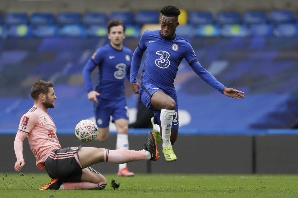 Chelsea's Callum Hudson-Odoi is challenged by Sheffield United's Oliver Norwood during the English FA Cup quarterfinal soccer match between Chelsea and Sheffield United at the Stamford Bridge stadium in London, Sunday, March 21, 2021. (AP Photo/Kirsty Wigglesworth)