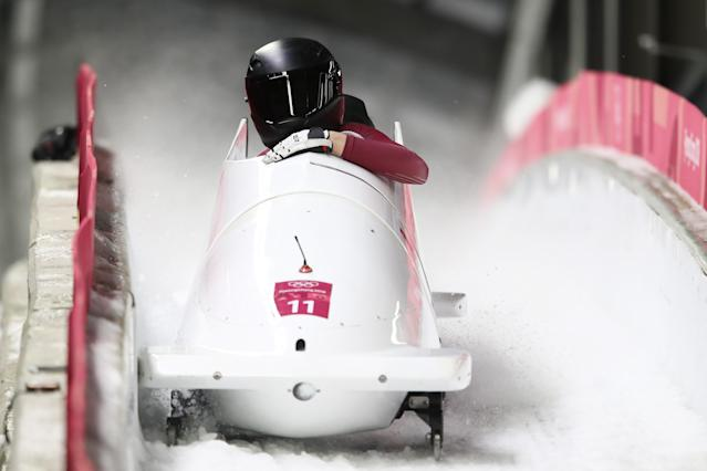Nadezhda Sergeeva and Anastasia Kocherzhova of the Olympic Athlete from Russia react in the finish area during the Women's Bobsleigh at the Olympic Sliding Centre on February 21, 2018 in Pyeongchang, South Korea. (Getty Images)