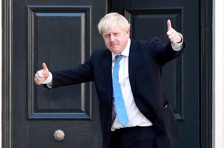 """(Bloomberg) -- Boris Johnson will formally take office as U.K. prime minister Wednesday and seek to build a government that will bring his Conservative Party together and deliver Brexit.The new leader, elected with two thirds of members votes, will give hardline Brexiteer Priti Patel a cabinet role and promote politicians of all stripes to try to reflect modern Britain, according to a person familiar with his plans.Johnson spent the hours after his victory Tuesday telling Conservative members of Parliament what most of them wanted to hear: the U.K. will leave the European Union on Oct. 31, and there won't be an early general election.It was a concerted effort to rally the troops before he takes office -- after Theresa May formally resigns to Queen Elizabeth II on Wednesday afternoon. Many Tory MPs fear Johnson will be forced to hold an election to try to break the parliamentary deadlock that destroyed his predecessor, but he assured them in a private meeting that it isn't his intention.Johnson's cabinet choices will show the sort of government he intends to lead, and he'll try to bring the party together when he starts to appoint ministers, the person said. The new premier will fill key roles, including chancellor of the exchequer, foreign secretary and home secretary on Wednesday and promote ethnic minority and women lawmakers to ministerial jobs, the person said.The Hard PartThe announcements will also be the moment when at least some of those who backed Johnson -- hoping for promotion -- will be disappointed, potentially creating enemies for the future.Former International Development Secretary Patel, forced out of May's cabinet in 2017 after a series of unauthorized meetings with the Israeli government, will be rewarded for her support with a return to cabinet. Employment Minister Alok Sharma will join her at the top table, the person said.'Vintage Boris'Johnson, who was foreign secretary when Patel lost her job, described her at the time as """"a very good colleag"""