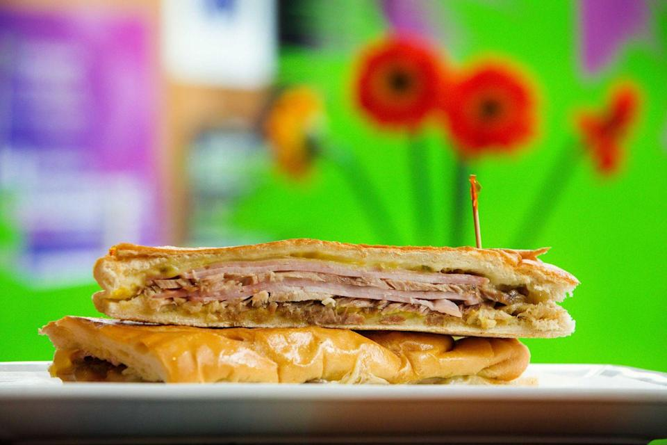 """<p><strong>Cubano</strong></p><p>South Floridans know a good Cubano when they see one. Made with two kinds of pork, Swiss cheese, mustard and pickles pressed on Cuban bread. While you can find this sandwich everywhere, <a href=""""https://www.versaillesrestaurant.com/"""" rel=""""nofollow noopener"""" target=""""_blank"""" data-ylk=""""slk:Versailles"""" class=""""link rapid-noclick-resp"""">Versailles</a> in Miami's Little Havana offers one that's not to be missed.</p>"""