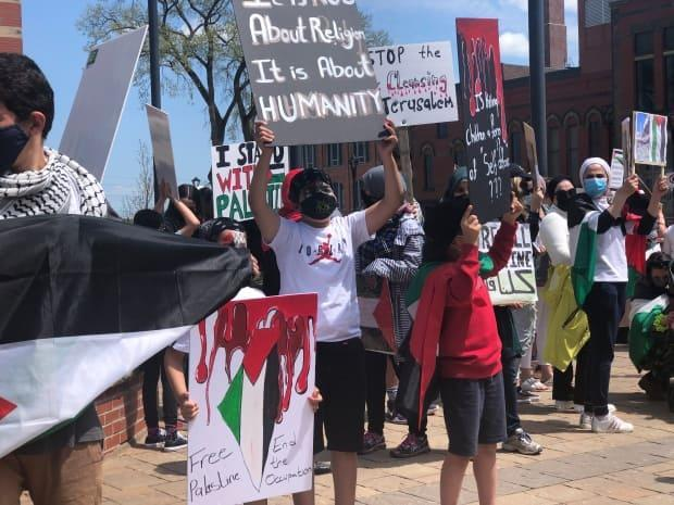 Pro-Palestinian supporters are shown at a demonstration in Fredericton.