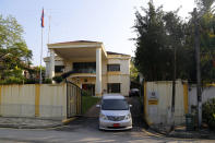A vehicle goes out of the North Korean Embassy in Kuala Lumpur, Malaysia, Saturday, March 20, 2021. Malaysia said Friday it will order all North Korean diplomats to leave the country within 48 hours, an escalation of diplomat brawl over Malaysia's move to extradite a North Korean suspect to the United States for money laundering charges. (AP Photo/Lai Seng Sin)