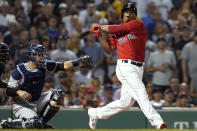 Boston Red Sox's Rafael Devers strikes out swinging next to New York Yankees catcher Gary Sanchez to end the third inning of a baseball game at Fenway Park, Friday, July 23, 2021, in Boston. (AP Photo/Elise Amendola)