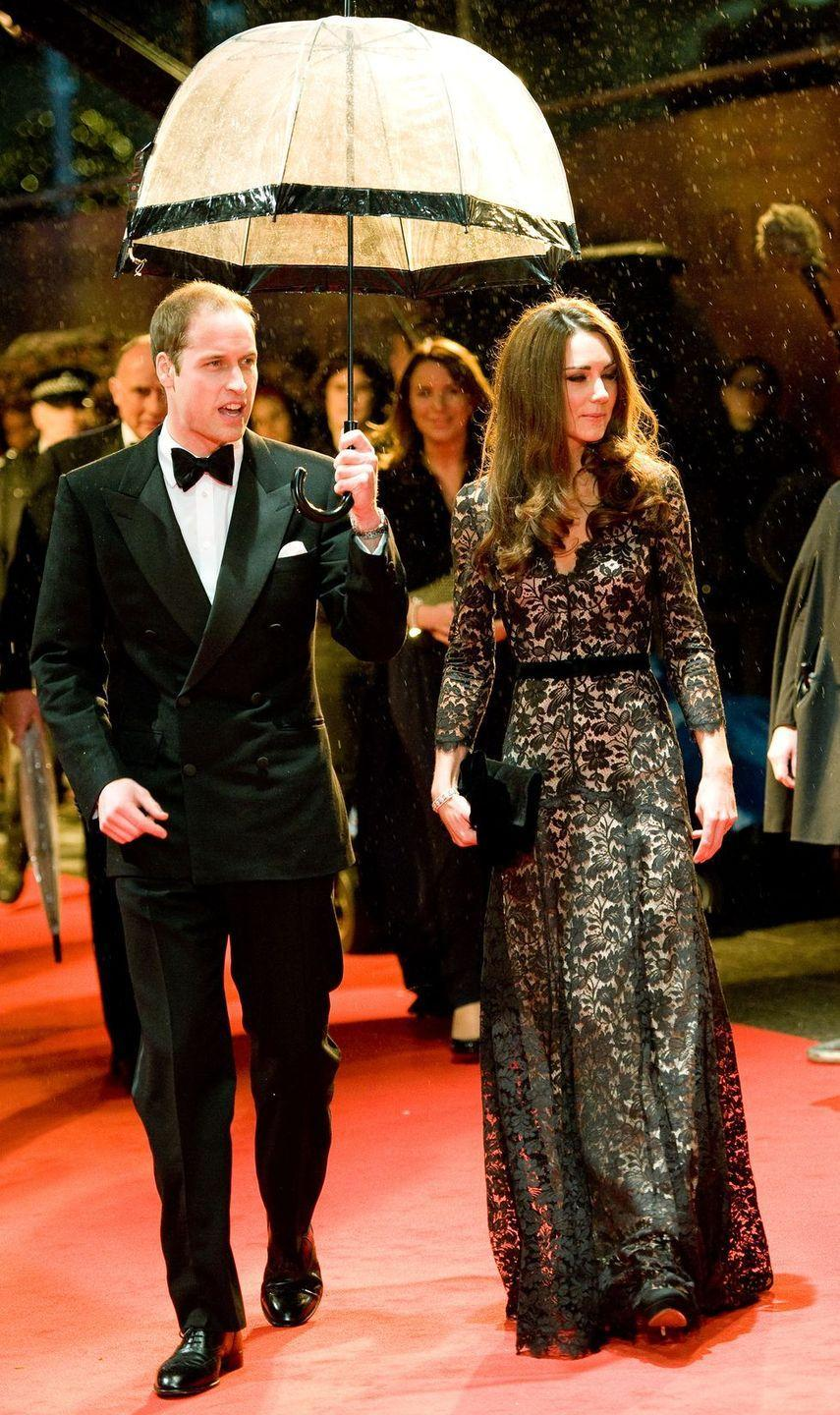 <p>This bubble umbrella was not sufficient to protect both the Duke and Duchess during the U.K. premiere of <em>War Horse.</em><br></p>