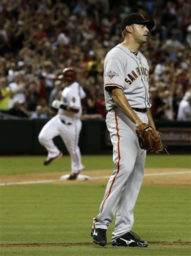San Francisco Giants' Jeremy Affeldt, right, reacts after giving up 3-run home run to Arizona Diamondbacks' Paul Goldschmidt, left, during the eighth inning of a baseball game on Friday, June 7, 2013, in Phoenix. The Diamondbacks won 3-1. (AP Photo/Ross D. Franklin)