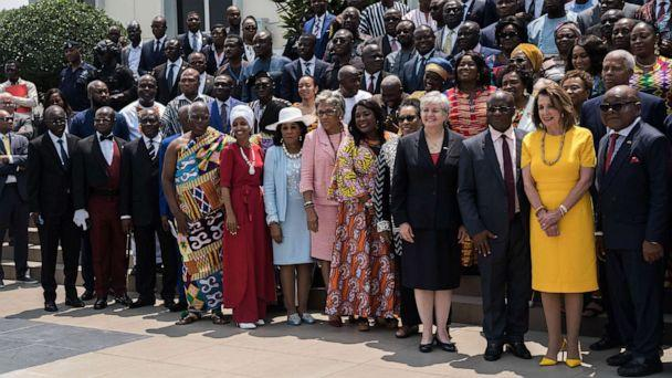 PHOTO: Speaker of the House Nancy Pelosi (2nd R), Speaker of Ghana's Parliament Mike Aaron Oquaye (R) and US Representative Ilhan Omar (5th L) pose for a family picture with members of Parliament in front of the Ghana's Parliament in Accra, July 31, 2019. (Natalija Gormalova/AFP/Getty Images)