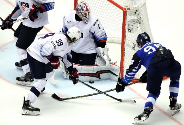 Ice Hockey - 2018 IIHF World Championships - Group B - Finland v USA - Jyske Bank Boxen - Herning, Denmark - May 15, 2018 - Miko Rantanen of Finland in action with Brian Gibbons and goaltender Keith Kinkaid of the U.S. REUTERS/David W Cerny