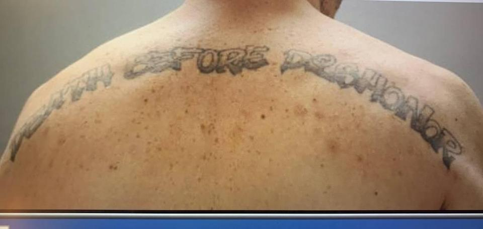 """McDowell's """"Death Before Dishonor"""" tattoo across his shoulders"""