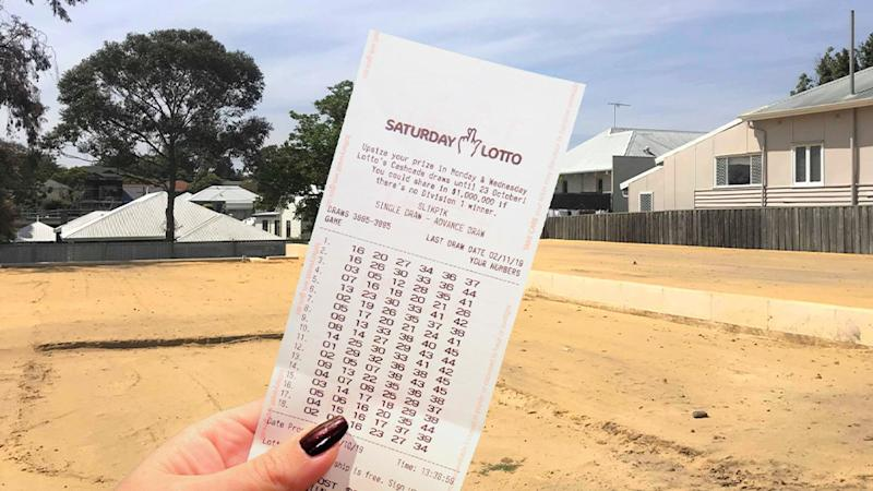 A winning Saturday Lotto ticket held up by a woman. A Perth couple, from Joondalup, won $1.23 million in the Saturday Lotto.