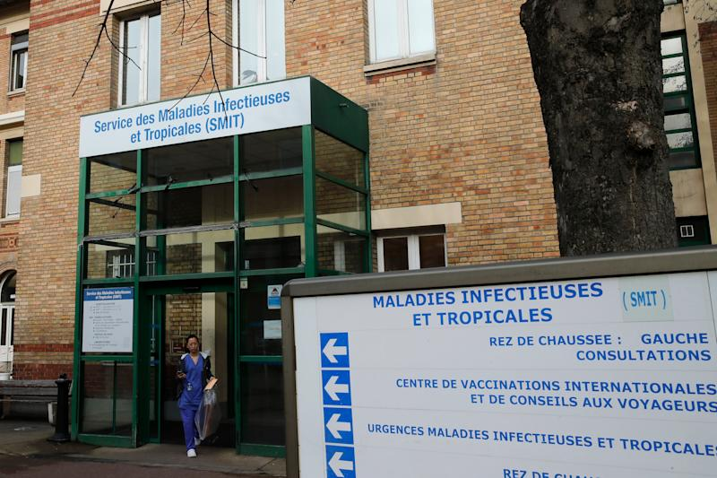 A medical staff leaves the department of Tropical Infections and diseases at the Bichat hospital, Wednesday, Jan. 29, 2020 in Paris.