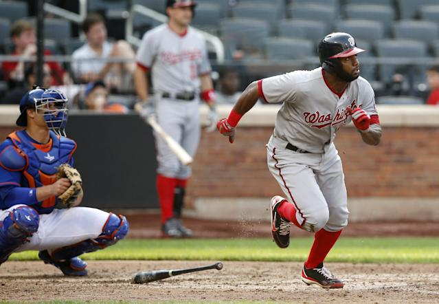 New York Mets catcher Anthony Recker, left, watches as Washington Nationals' Denard Span, right, hits an eighth-inning double during a baseball game on Thursday, Sept. 12, 2013, in New York. (AP Photo/Kathy Willens)