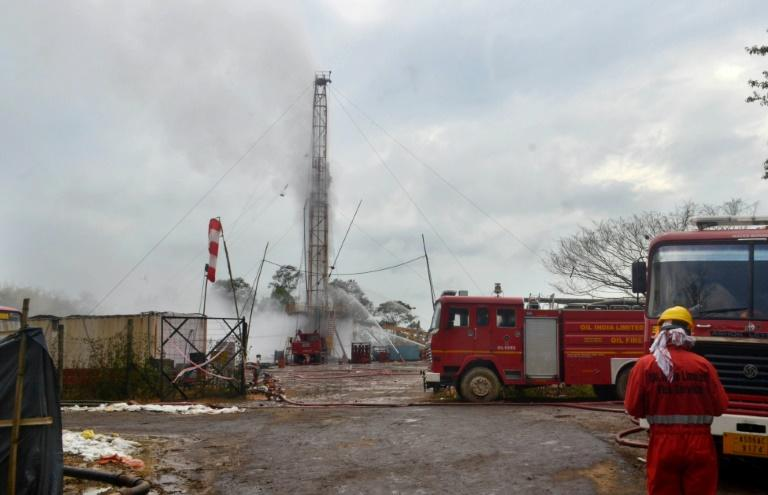 An Oil India Limited (OIL) firefighter is pictured after the gas well explosion in Assam state's Tinsukia district, which led to evacuations and fears for the environment