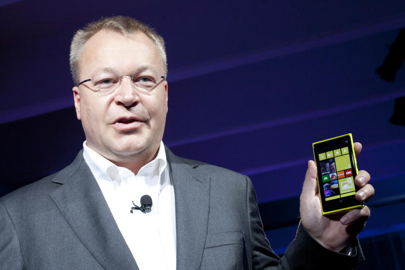 FILE - This is a Wednesday, Sept. 5, 2012 file photo of Stephen Elop, CEO  of Nokia, as he introduces its newest smartphone, the Lumia 920, equipped with Microsoft's Windows Phone 8 in New York. Nokia continues to take a hammering in the smartphone market from rivals Samsung and Apple with sales for the handset maker falling by a quarter in the first quarter. Although the Finland-based company managed to reduce its first-quarter net loss to euro272 million ($357 million) from a loss of euro928 million a year earlier, mainly thanks to cost cutting, net revenue dropped by 25 percent to euro5.8 billion . Nokia's share price plunged 10 percent to 2.39 euros in Helsinki, following the announcement Thursday April 18, 2013.  (AP Photo/Mark Lennihan)