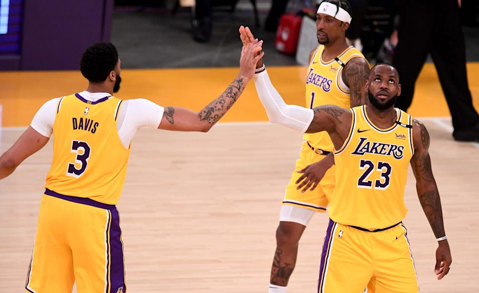Los Angeles, CA - May 19:  LeBron James #23 high fives teammate Anthony Davis #3 of the Los Angeles Lakers after scoring against the Golden State Warriors in the second half of a NBA basketball Western Conference Play-In game at the Staples Center in Los Angeles on Wednesday, May 19, 2021. (Photo by Keith Birmingham/MediaNews Group/Pasadena Star-News via Getty Images)