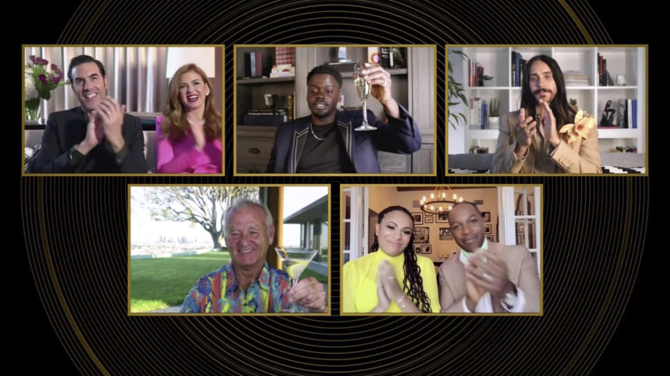 """In this video grab issued Sunday, Feb. 28, 2021, by NBC, nominees in the category for best supporting actor in a motion picture react as Daniel Kaluuya, top center, is announced as the winner for his role in """"Judas and the Black Messiah"""" at the Golden Globe Awards. (NBC via AP)"""