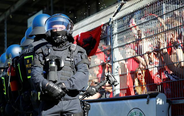 Soccer Football - 2. Bundesliga - SV Sandhausen v Nuremberg - BWT-Stadion am Hardtwald, Sandhausen, Germany - May 6, 2018 Nuremberg fans as police look on REUTERS/Kai Pfaffenbach DFL RULES TO LIMIT THE ONLINE USAGE DURING MATCH TIME TO 15 PICTURES PER GAME. IMAGE SEQUENCES TO SIMULATE VIDEO IS NOT ALLOWED AT ANY TIME. FOR FURTHER QUERIES PLEASE CONTACT DFL DIRECTLY AT + 49 69 650050