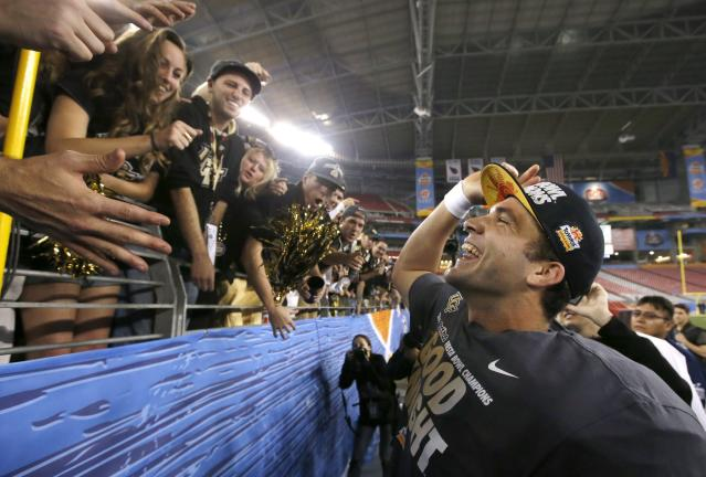 Central Florida's Blake Bortles smiles as he celebrates with fans after the Fiesta Bowl NCAA college football game win against Baylor Wednesday, Jan. 1, 2014, in Glendale, Ariz. Central Florida defeated Baylor 52-42. (AP Photo/Ross D. Franklin)