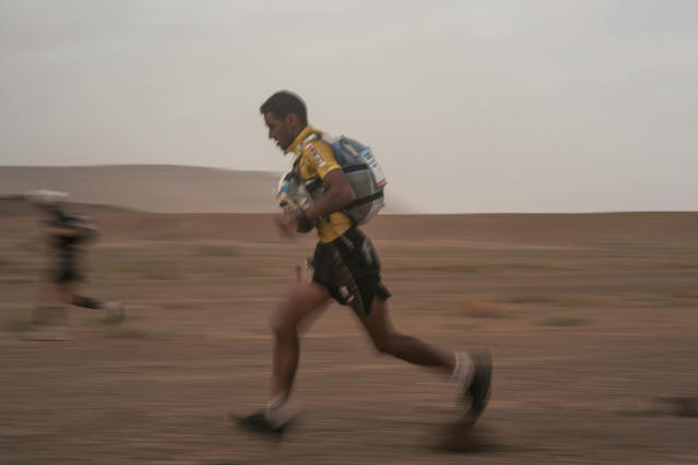 Rachid El Morabity, the 1st place winner, crosses a checkpoint during the 33rd edition of Marathon des Sables, in the Sahara desert, near Merzouga, southern Morocco, Friday, April 13, 2018. Under a hot desert sun and with the desolation of the Sahara all around, about 1,000 competitors from 50 countries took part in this year's Marathon des Sables, or Marathon of the Sands. The 33rd edition of the annual race, considered to be one of the most demanding ultramarathons in the world, finished Saturday after six grueling days and about 250 kilometers (150 miles).(AP Photo/Mosa'ab Elshamy)