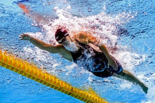 Five-time Olympic swimming champion Katie Ledecky has smashed her own 1,500m freestyle world record by five seconds