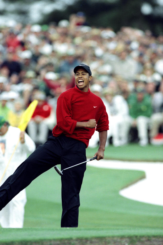 Tiger Woods celebrates on the eighteenth green after winning the 1997 Masters tournament at Augusta National Golf Club in Georgia, on April 13 1997. Woods finished with a record eighteen-under-par. (AFP Photo/Timothy A. CLARY)