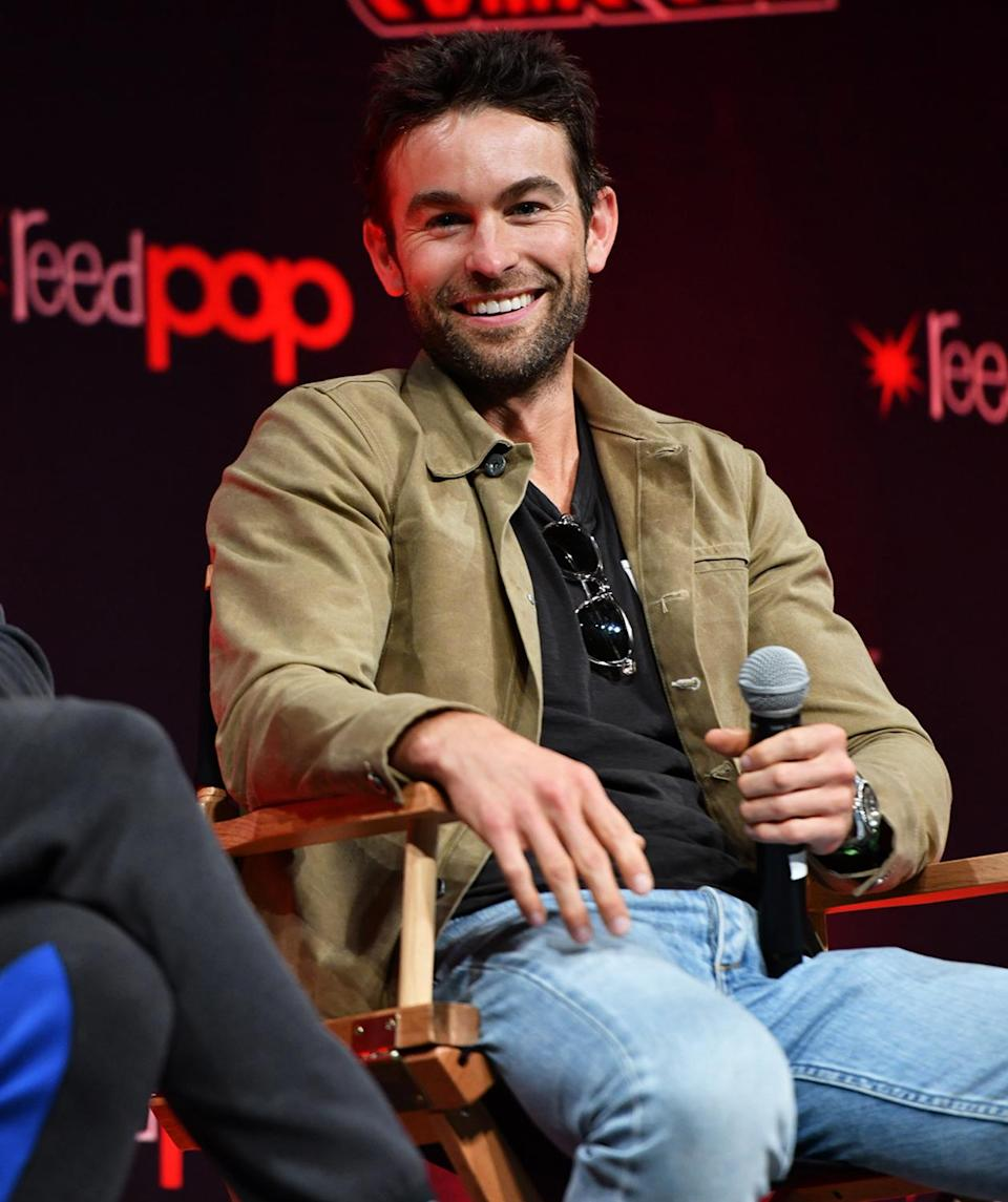 <p>Chace Crawford flashes a smile onstage during <em>The Boys</em> panel at New York Comic Con on Oct. 8. </p>