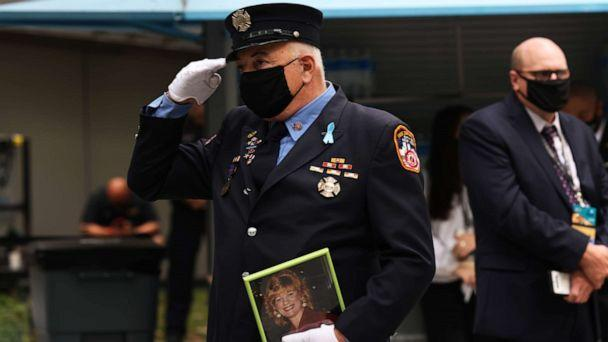 PHOTO: A firefighter salutes while listening to the National Anthem during a 9/11 memorial service at the National September 11 Memorial and Museum on Sept. 11, 2020 in New York City. (Michael M. Santiago/Getty Images)